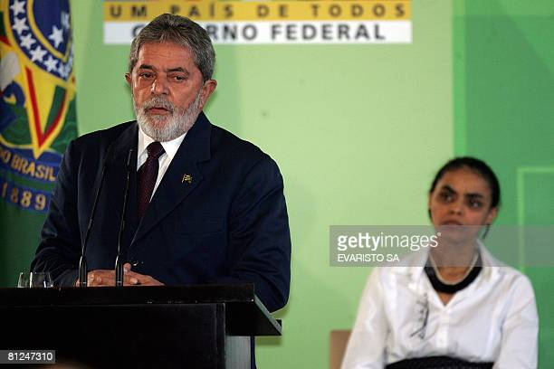 Brazilian President Luiz Inacio Lula Da Silva delivers a speech as outgoing Minister of Environment Marina Silva looks on during the inauguration...