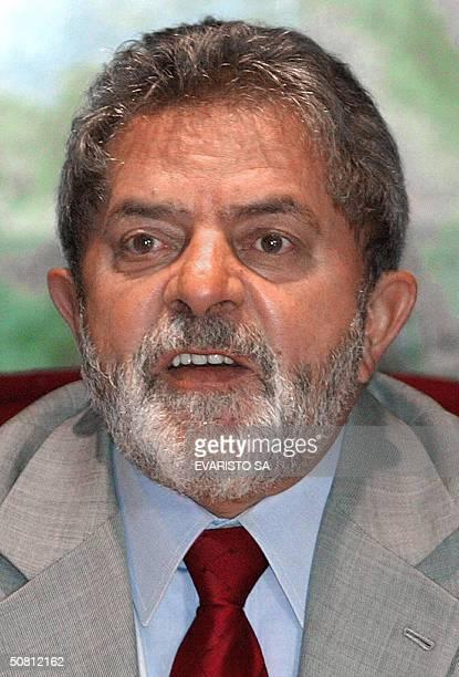 Brazilian President Luiz Inacio Lula da Silva gestures during a meeting 07 May, 2004 at the Planalto palace in Brasilia. The Brazilian markets closed...