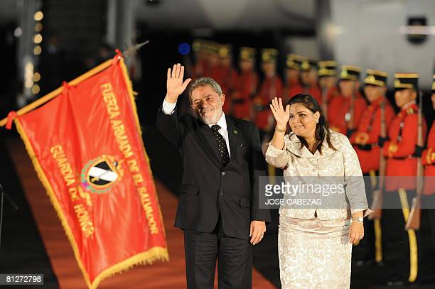 Brazilian President Luiz Inacio Lula da Silva is welcomed by Salvadorean Minister of Foreign Affairs Marisol Argueta de Barillas upon his arrival on...