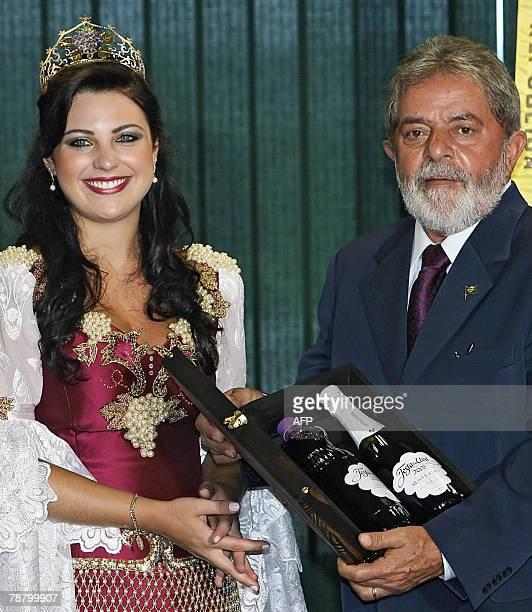 Brazilian President Luiz Inacio Lula da Silva receives bottles of wine from the princess of the Grape Festival of Caxias do Sul Paula da Costa...
