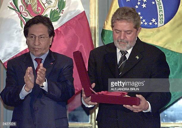 Brazilian President Luiz Inacio Lula da Silva receives the posthumous Sol de Peru Order from Peruvian President Alejandro Toledo for Sergio Viera de...