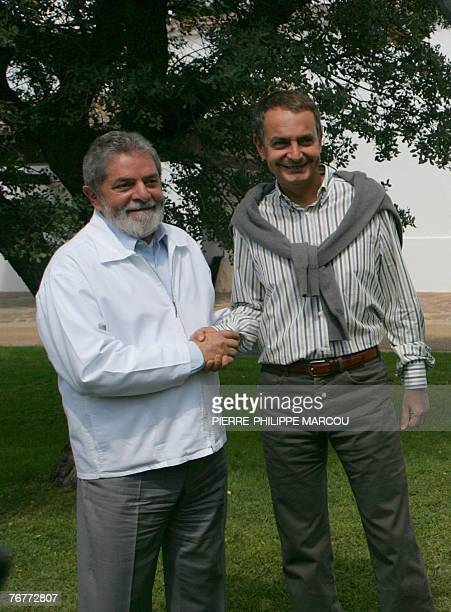 Brazilian President Luiz Inacio Lula da Silva shakes hands with Spanish Prime Minister Jose luis Rodriguez Zapatero at the Quintos de Mora ranch near...