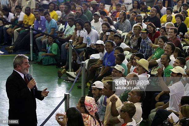 Brazilian President Luiz Inacio Lula da Silva shares a joke with the audience during a meeting with homeless people and recycling materials...
