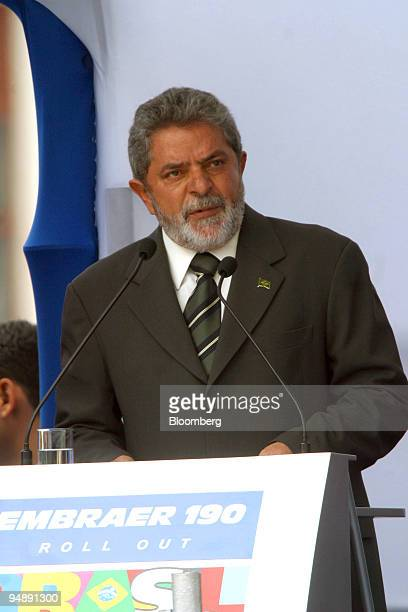 Brazilian President Luiz Inacio Lula da Silva speaks during a rollout ceremony for the new Embraer 190 regional jetliner at the company's...