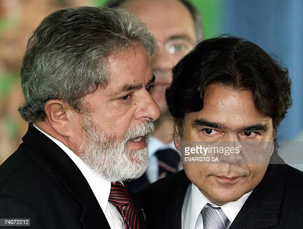 Brazilian President Luiz Inacio Lula da Silva whispers to Brazilian Health Minister Jose Carlos Temporao during a ceremony at Planalto Palace in...