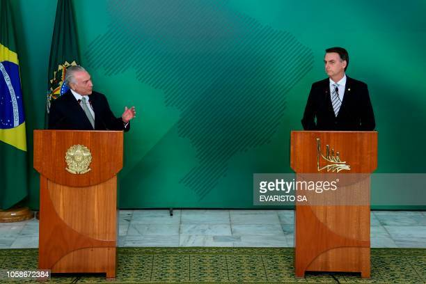 Brazilian President Michel Temer and Brazilian presidentelect Jair Bolsonaro deliver a joint press conference after a meeting in Brasilia on November...