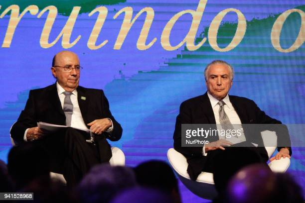 Brazilian President Michel Temer and his Finance Minister Henrique Meirelles are pictured during the BrazilArab Economic Forum held at the Hotel...