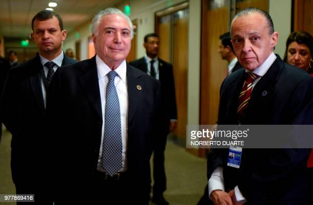 Brazilian President Michel Temer and his Foreign Minister Aloisyo Nunes are pictured before the Mercosur Summit in Luque Paraguay on June 18 2018...