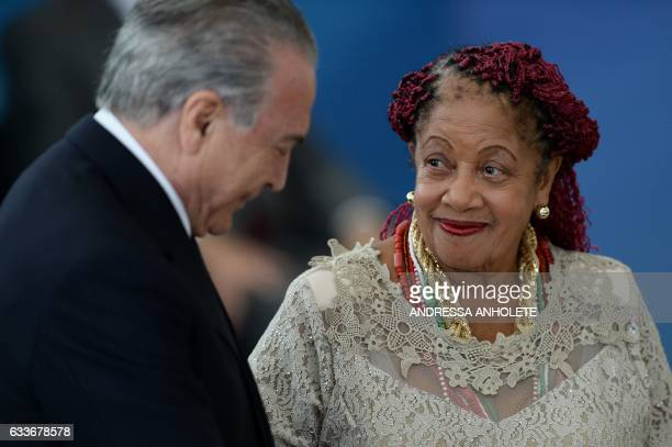 Brazilian President Michel Temer and Human Rights Minister Luislinda Valois talk during the inauguration ceremony of the ministers of Justice and...