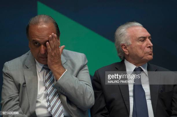 Brazilian President Michel Temer and Rio de Janeiro's Governor Luiz Fernando Pezao take part in an event announcing the beginning of the final stage...