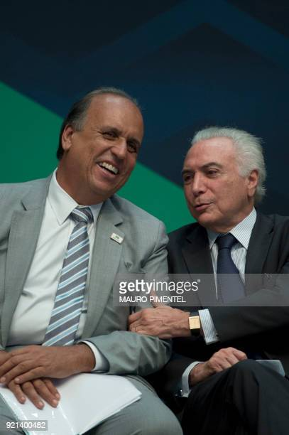 Brazilian President Michel Temer and Rio de Janeiro's Governor Luiz Fernando Pezao speak during an event announcing the beginning of the final stage...