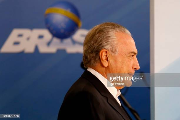 Brazilian President Michel Temer arrives to deliver a new statement following the release of a tape allegedly demonstrating him condoning bribery...