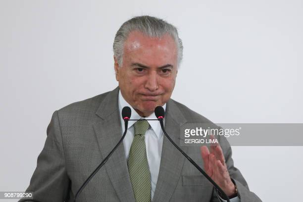 Brazilian President Michel Temer delivers a speech during a ceremony to announce the expansion and modernization of Brasilia's subway system at...