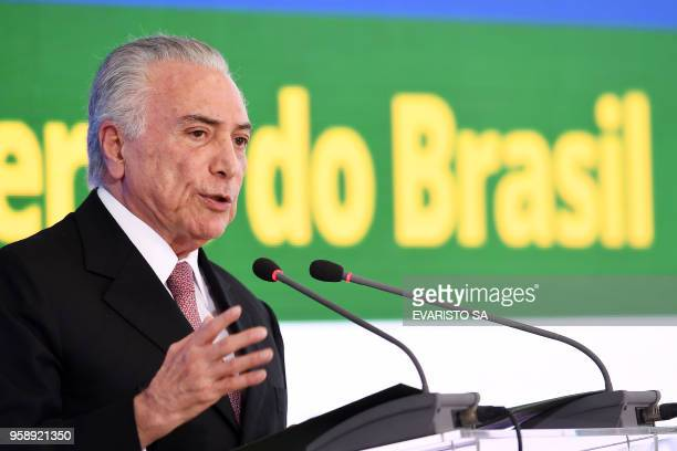 Brazilian President Michel Temer delivers a speech during a ceremony celebrating two years in government at the Planalto Palace in Brasilia on May 15...