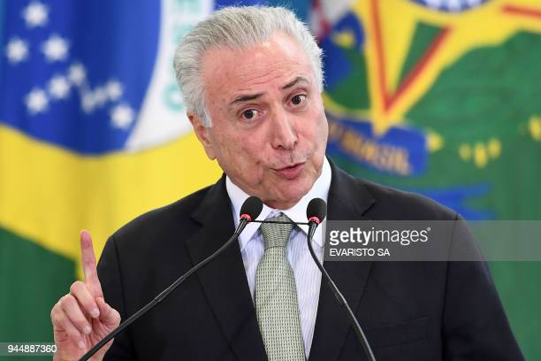 Brazilian President Michel Temer delivers a speech during the presentation ceremony for promoted general officers at the Planalto Palace in Brasilia...