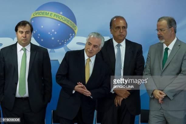 Brazilian President Michel Temer deputy Rodrigo Maia Rio de Janeiro's Governor Luiz Fernando Pezao and Defense Minister Raul Jungmann are pictured...