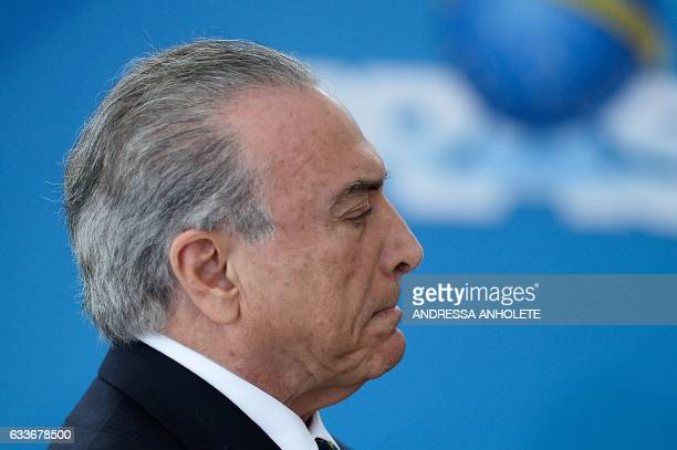 Brazilian President Michel Temer gestures during the inauguration ceremony of the ministers of Justice and Public Security Alexandre de Moraes of...