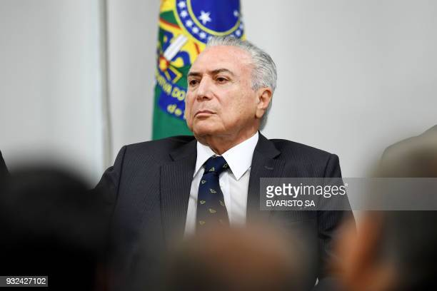 Brazilian President Michel Temer gestures during the signing ceremony of an agreement for the construction of a Bus Rapid Transit system in Goiania...