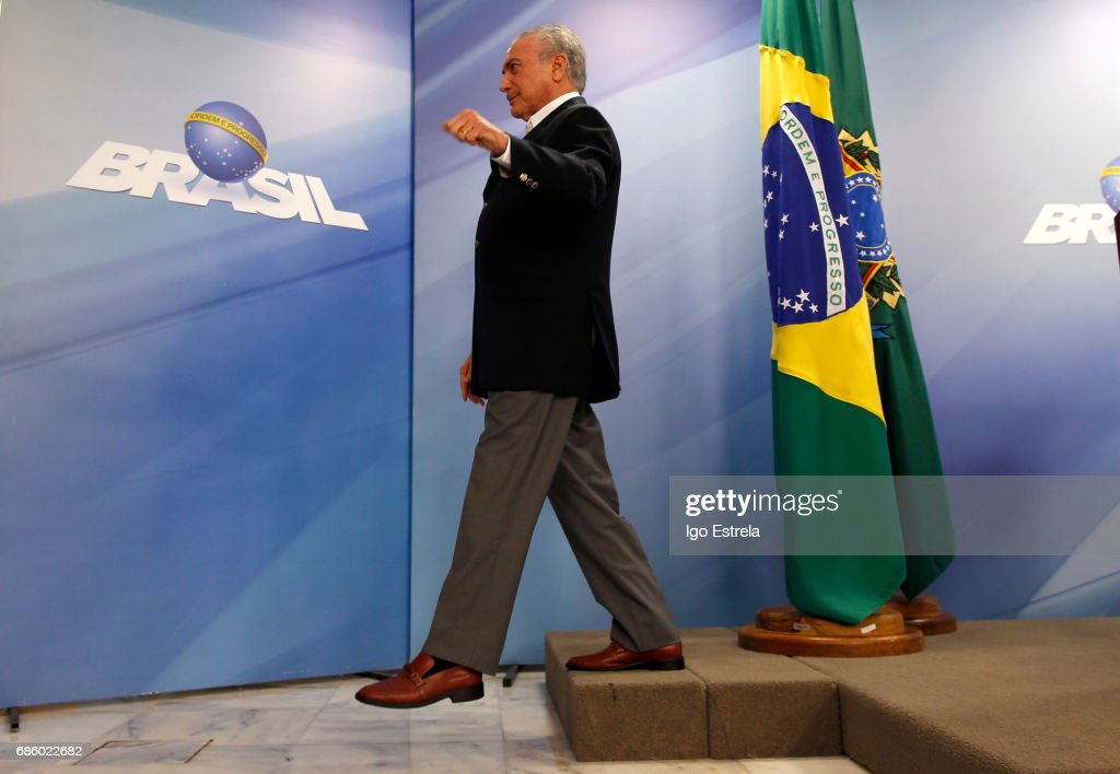 Brazilian President Michel Temer leaves after delivering a new statement following the release of a tape allegedly demonstrating him condoning bribery payments to Chamber of Deputies President Eduardo Cunha on May 20, 2017 in Brasilia, Brazil. The release of the recording has sent another political shockwave through the country with leftists calling for Temer's impeachment and new elections.