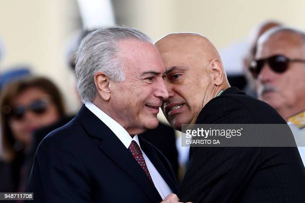 TOPSHOT Brazilian President Michel Temer listens to Supreme Court Judge Alexandre de Moraes during a parade on the Brazilian Army commemorative day...