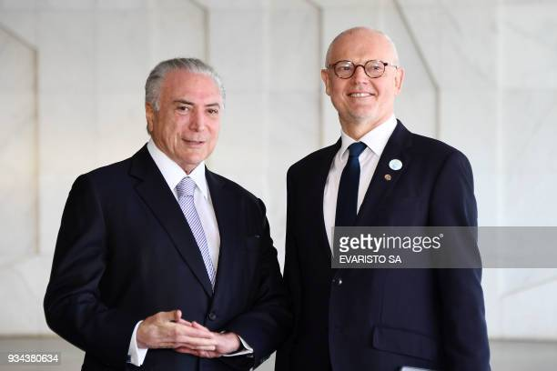 Brazilian President Michel Temer welcomes Monaco's State Minister Serge Telle before the opening ceremony of the 8th World Water Forum at Itamaraty...
