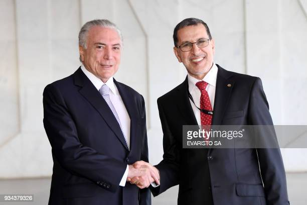 Brazilian President Michel Temer welcomes Morocco's Prime Minister Saad Eddine El Othmani before the opening ceremony of the 8th World Water Forum at...