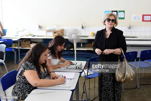 Brazilian President of High Electoral Court Jugde Rosa Weber votes during general elections in a poll station in Brasilia on October 28 2018...