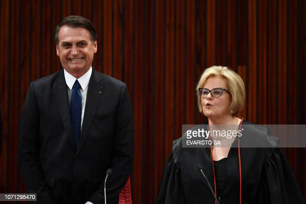 Brazilian Presidentelect Jair Bolsonaro and Electoral Supreme Court president Justice Rosa Weber attend a ceremony in which he received a diploma...