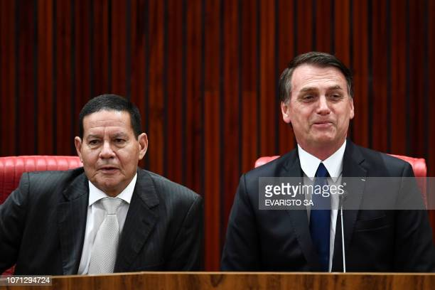 Brazilian Presidentelect Jair Bolsonaro and his VicePresidentelect Hamilton Mourao attend a ceremony in which they received diploma that certify they...
