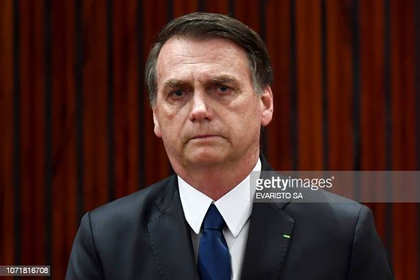 Brazilian Presidentelect Jair Bolsonaro cries during a ceremony in which he received a diploma that certifies he can take office as president from...