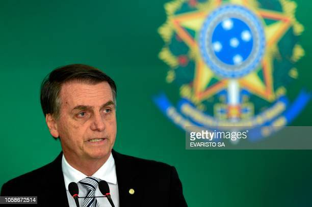 Brazilian presidentelect Jair Bolsonaro delivers a joint press conference with Brazilian President Michel Temer after a meeting in Brasilia on...