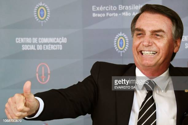 Brazilian Presidentelect Jair Bolsonaro gestures as he addresses the press after a meeting at the Brazilian Army's headquarters in Brasilia on...