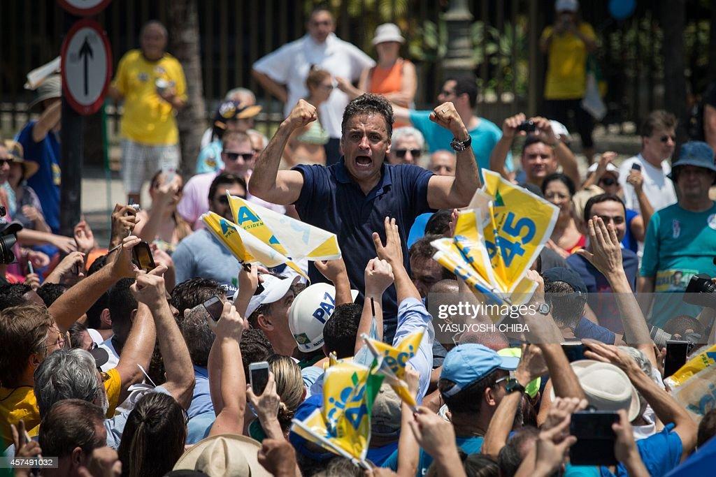 Brazilian presidential candidate for the Brazilian Social Democracy Party (PSDB), Aecio Neves, gestures at supporters during his campaign at Copacabana beach in Rio de Janeiro, Brazil, on October 19, 2014. Neves will face current Brazilian President and candidate for the Brazilian Workers Party (PT) Dilma Rousseff in a run-off election next October 26.