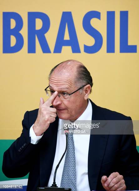 Brazilian presidential candidate for the Brazilian Social Democratic Party Geraldo Alckmin gestures during a press conference with foreign...