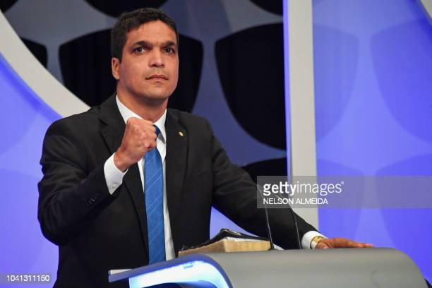 Brazilian presidential candidate for the Patriota party Cabo Daciolo gestures during the presidential debate ahead of the October 7 general election...
