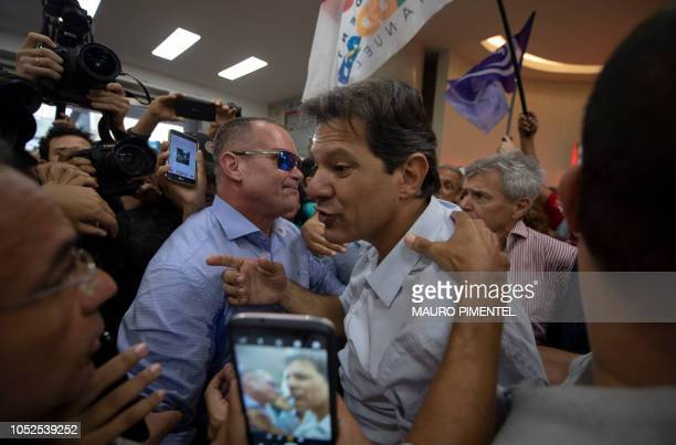 Brazilian presidential candidate for the Workers Party Fernando Haddad greets supporters during a visit to the Engineering Club in Rio de Janeiro...