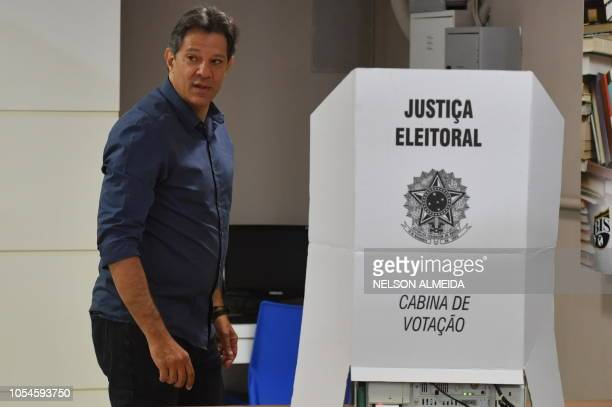 Brazilian presidential candidate for the Workers Party Fernando Haddad votes at a polling station in Sao Paulo Brazil during the second round of the...