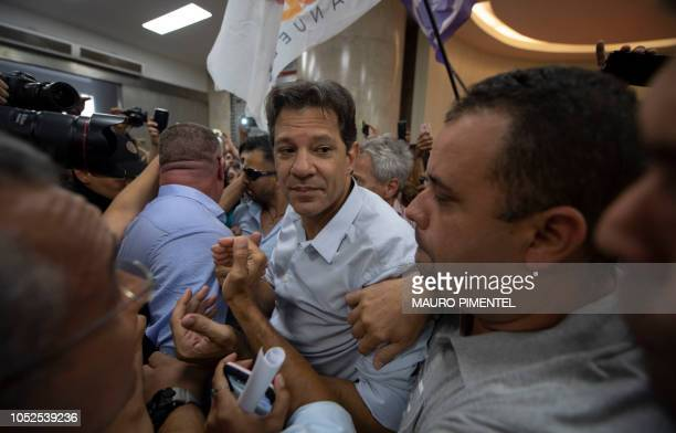 Brazilian presidential candidate for the Workers Party Fernando Haddad walks amid supporters during a visit to the Engineering Club in Rio de Janeiro...