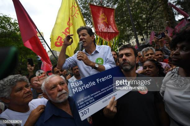 Brazilian presidential candidate for the Workers Party Fernando Haddad speaks next to a sign reading 'Marielle Franco Street' referring to the...