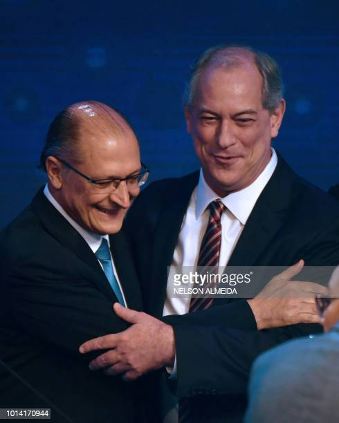 Brazilian presidential candidates Geraldo Alkmin and Ciro Gomes greet each other before the first presidential debate ahead of the October 7 general...