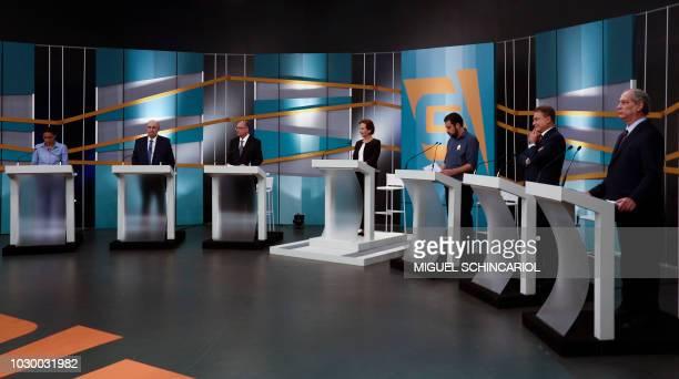 Brazilian presidential candidates Marina Silva Henrique Meirelles Geraldo Alckmin Guilherme Boulos Alvaro Dias and Ciro Gomes stand next to...