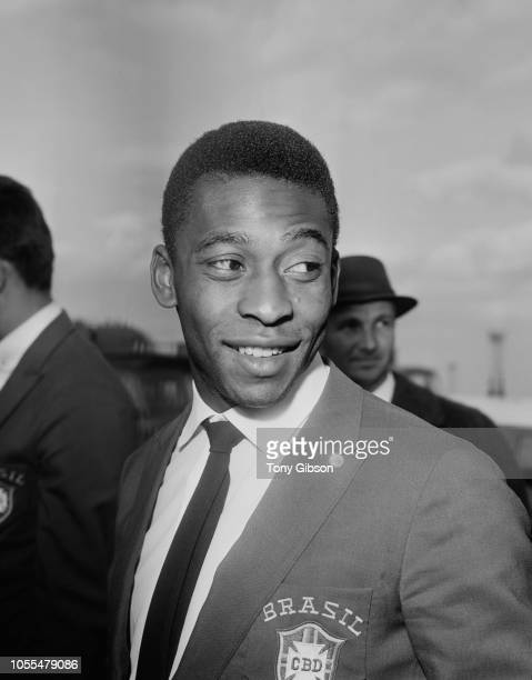 Brazilian professional footballer Pele pictured arriving at London airport with the Brazil national team ahead of their upcoming International...