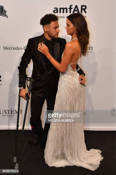 Brazilian PSG's footballer Neymar Junior and girlfriend Bruna Marquezine attend the photocall for the 2018 American Foundation for AIDS Research Gala...
