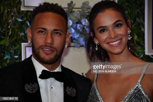 Brazilian PSG's footballer Neymar Junior and his girlfriend Bruna Marquezine arrive to participate in the charity auction of the Neymar Jr Institute...