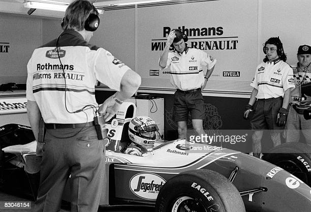 Brazilian race car driver Ayrton Senna and the Williams F1 Racing Team crew during a qualifying session for the San Marino F1 Grand Prix on the Imola...