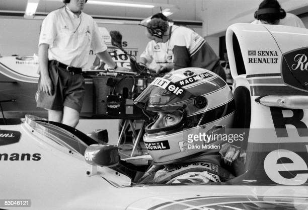 Brazilian race car driver Ayrton Senna sits in a racecar as he prepares for a qualifying round of the San Marino F1 Grand Prix on the Imola Circuit...
