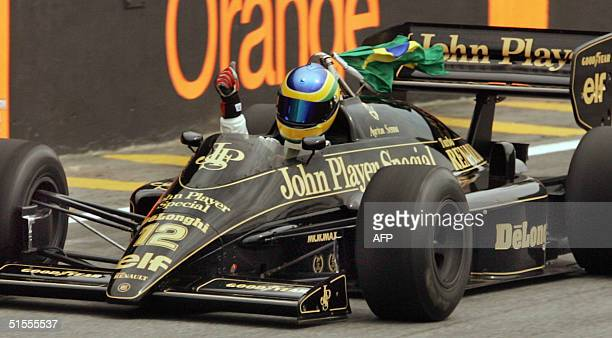 Brazilian race driver Bruno Senna powers an old Lotus model 24 October, 2004 paying tribute to former F1 driver and three times World Champion Ayrton...