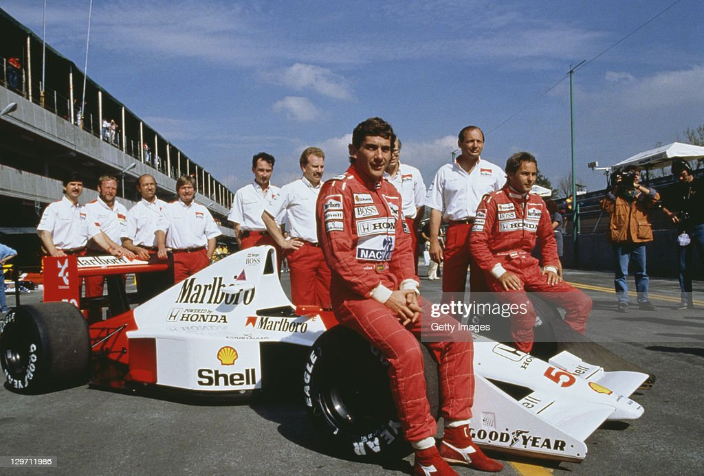 Brazilian racing driver Ayrton Senna (1960 -1994, centre) and his Austrian teammate Gerhard Berger (right) pose with the rest of the McLaren team at the Mexican Grand Prix at the Mexico City circuit, 24th June 1990.