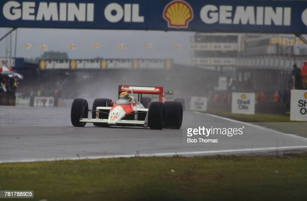 Brazilian racing driver Ayrton Senna drives the Honda Marlboro McLaren McLaren MP4/4 Honda RA168E 15 V6t to finish in first place to win the 1988...