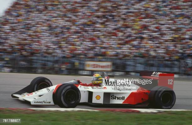 Brazilian racing driver Ayrton Senna drives the Honda Marlboro McLaren McLaren MP4/4 Honda RA168E 15 V6t in the 1988 Brazilian Grand Prix at the...